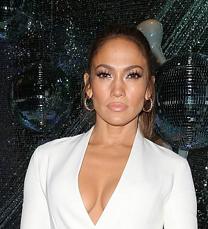 Jennifer Lopez plays coy over Drake question on Grammy Awards red carpet