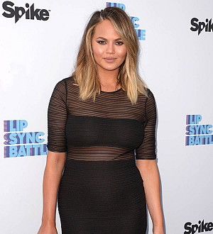 Chrissy Teigen not yet ready slip back into bikini