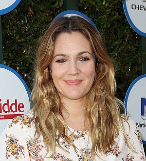 Drew Barrymore & husband looked 'perfectly happy' at pal's wedding
