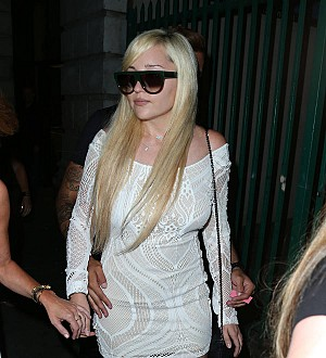 Amanda Bynes confirms pregnancy and engagement tweets are bogus