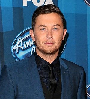 Singer Scotty McCreery cited for carrying loaded gun through airport security