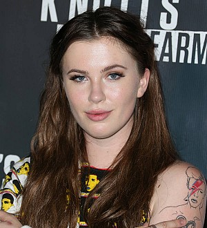 Ireland Baldwin brushes off dating rumors with dad's prying texts
