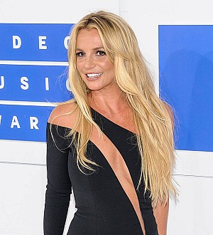 Britney Spears thrilled by boob-popping stage mishap