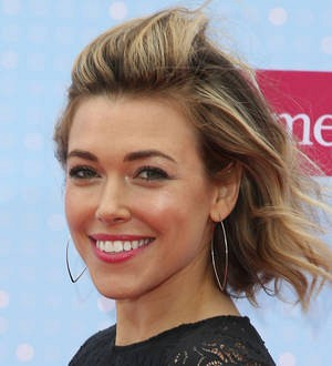 Singer Rachel Platten cries as she meets young cancer patients