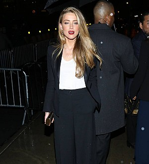 Amber Heard all smiles as she leaves lawyers' office