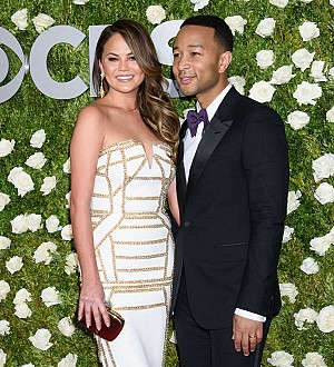 Chrissy Teigen bares a boob onstage at husband's New York gig