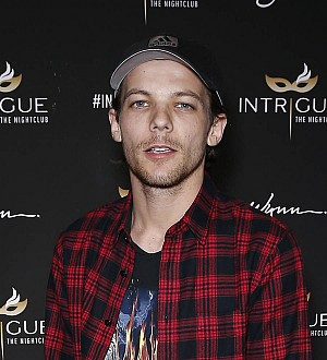 Louis Tomlinson ready to fight for more time with baby son