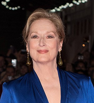 Protesters lie down on the red carpet at Meryl Streep premiere