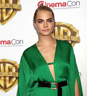 Cara Delevingne debuts new hairstyle at Comic-Con