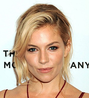 Sienna Miller tackles daughter's head lice