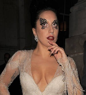 Lady Gaga falls over during Monaco show