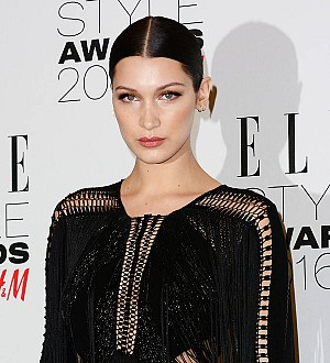 Bella Hadid apologises to mum over topless photo