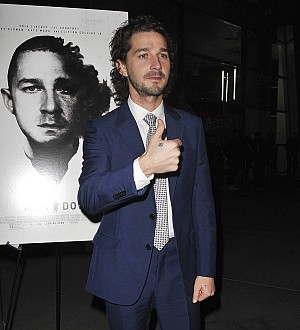 Shia LaBeouf returns to protest after assault arrest