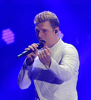 Nick Carter chokes up discussing family amid feud with brother Aaron
