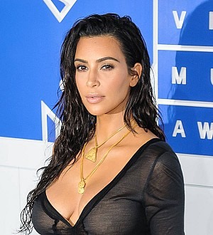 Kim Kardashian demands apology from blogger who alleged she 'faked' robbery