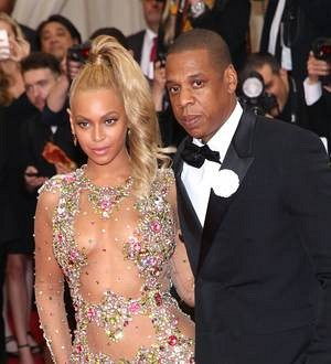 Beyonce and Jay Z cuddle up at Usher's film premiere