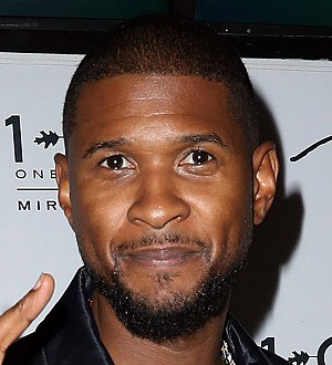 Usher and Ludacris consoled by Mark Wahlberg after Super Bowl loss