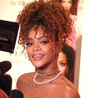 Rihanna auctioning off 2014 Christmas tree at Diamond Ball charity event