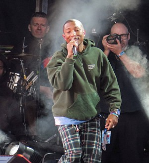 Pharrell Williams brings sick fan onstage at Philadelphia concert