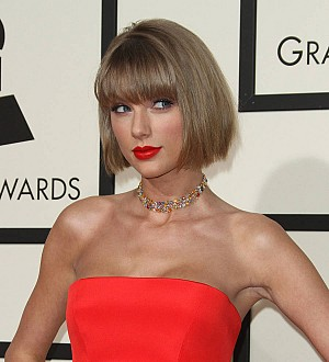 Taylor Swift celebrates early Grammys double win