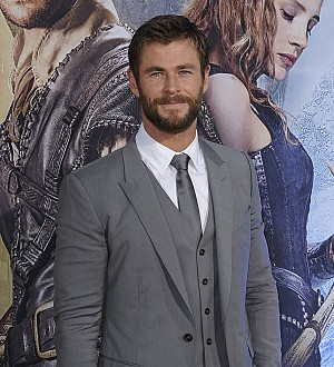 Chris Hemsworth attacked by 'wild dog' on beach run