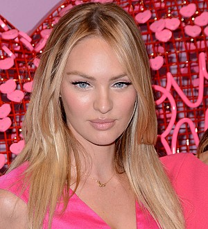 Model Candice Swanepoel left bloodied after runway fall