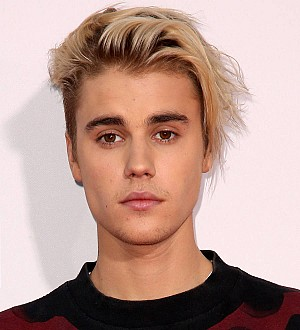 Justin Bieber settles legal battle with photographer