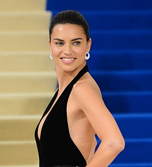 Adriana Lima commits to herself with new wedding bling