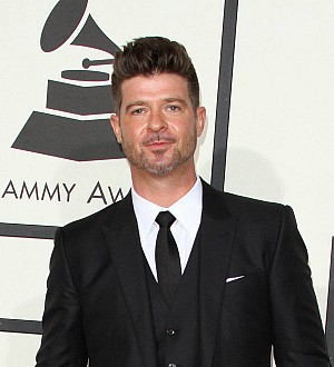 Robin Thicke skips gala appearance following tense custody battle