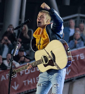 Justin Bieber makes U.S. chart history with top three tunes