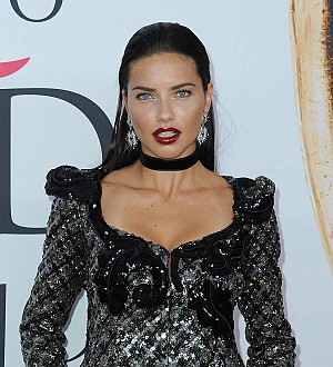 Adriana Lima sheds proud tears at Olympic torch-lighting ceremony