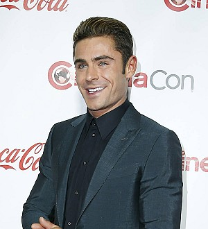 Dwayne Johnson loses bet to Zac Efron