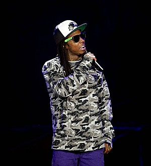 Lil Wayne thanks fans for support amid seizure drama