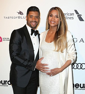 Pregnant Ciara and family strip off for intimate photo