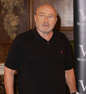 Phil Collins returns to the stage following nasty fall