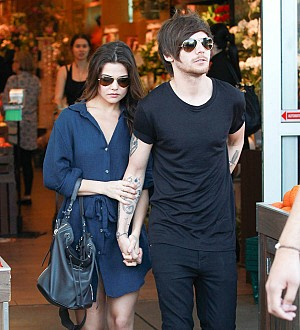 Louis Tomlinson's girlfriend coos about One Direction star's daddy skills