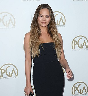 Chrissy Teigen poses in swimsuit for the first time since giving birth
