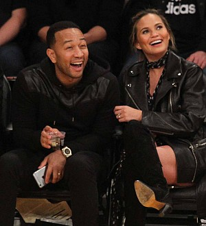 New parents John Legend and Chrissy Teigen 'happy and elated'