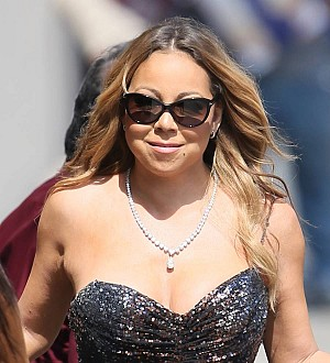 Mariah Carey buys wedding dress despite divorce delay
