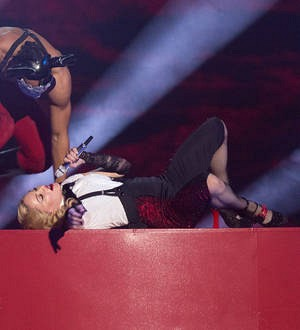 Stars defend Madonna as fall footage goes viral