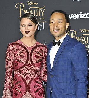 Chrissy Teigen lives out fantasy as she reenacts Spider-Man kiss with John Legend