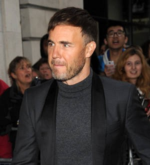 Take That regroup to switch on London's Christmas lights