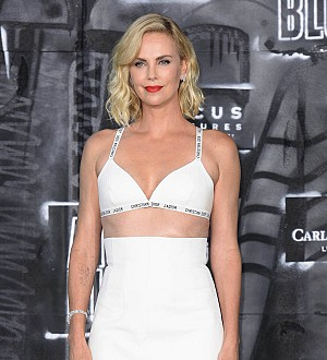 Charlize Theron enjoys having sex with both men and women onscreen