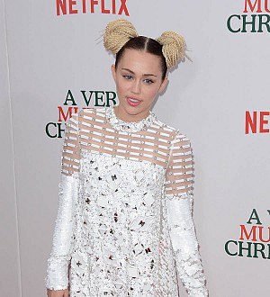 Miley Cyrus ditches wild ways for Liam Hemsworth