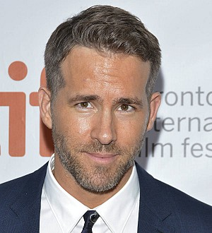 Ryan Reynolds takes on testicular cancer as movie superhero Deadpool