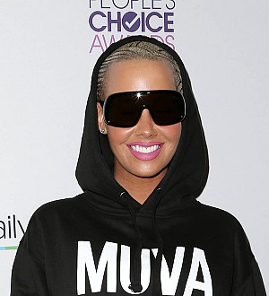 No more rap romances for Amber Rose after Wiz and Kanye