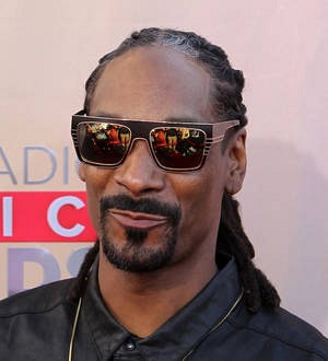 Snoop Dogg raced back from U.K. festival to attend son's graduation