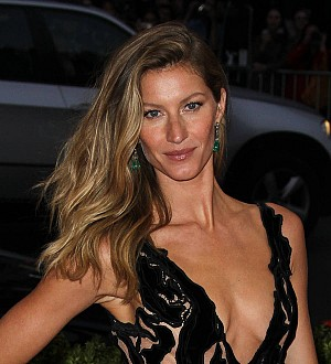 Gisele goes topless for new Givenchy Jeans ad