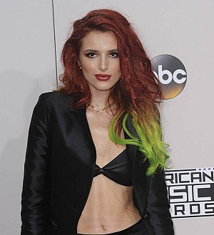 Bella Thorne rings in the New Year with smooch from gal pal