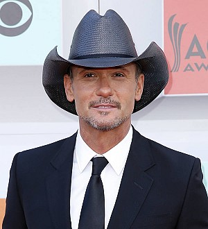 Tim McGraw adds his name to the list of celebrity wedding singers